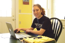 Photo of Sadie editing the Research Clearinghouse